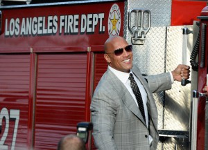 Dwayne 'The Rock' Johnson Poses On A Firetruck At 'San Andreas' Premiere