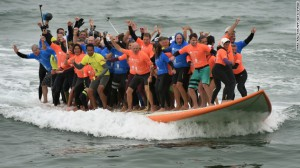66 Surfers Climb On Giant Surfboard To Break World Record