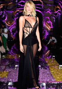 Rosie Huntington-Whiteley Wears Black Gown Front Row At Atelier Versace Runway Show