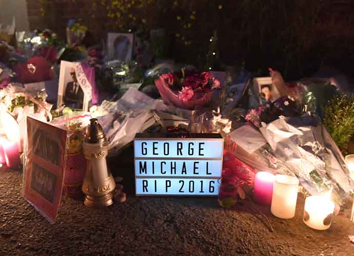 Fans Leave Flowers & Tributes On George Michael's Door