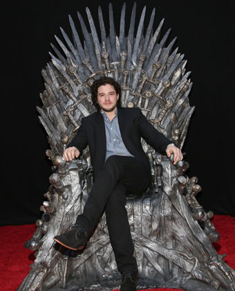 Kit Harington On The Iron Throne