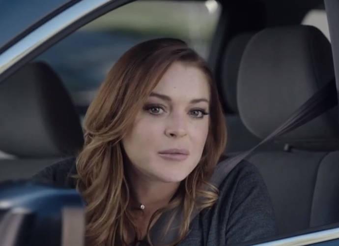"Lindsay Lohan Is ""Sorta"" A Mom, Definitely A Bad Driver In Esurance Super Bowl Ad"