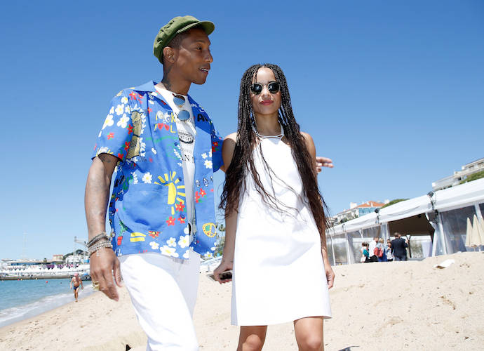 Pharrell Williams & Zoe Kravitz Hit The Beach For 'Dope' Photocall AtCannes