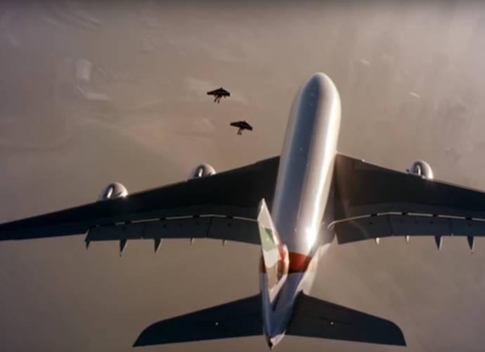 Jetpack-Wearing Daredevils Yves Rossy And Vince Reffet Fly Alongside Airliner Over Dubai