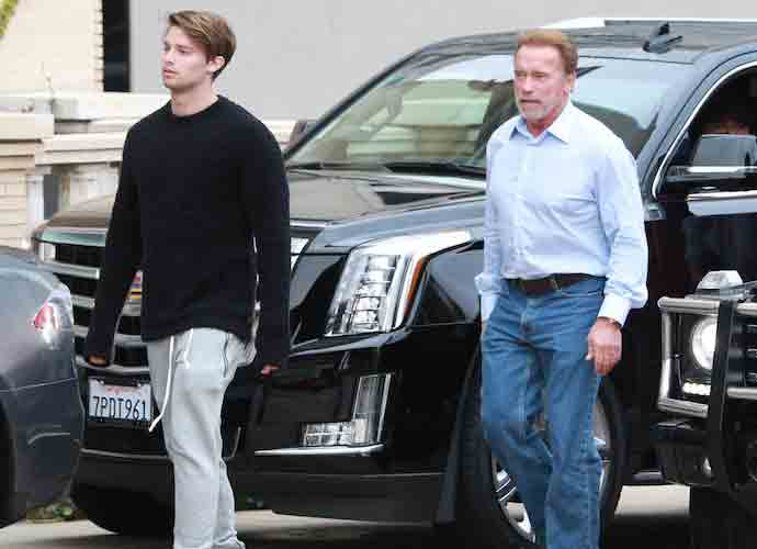 Arnold Schwarzenegger And His Son Patrick Go Shopping In Beverly Hills