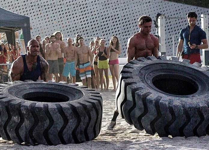 The Rock And Zac Efron Compete In Tire Shrugging Contest On 'Baywatch' Set
