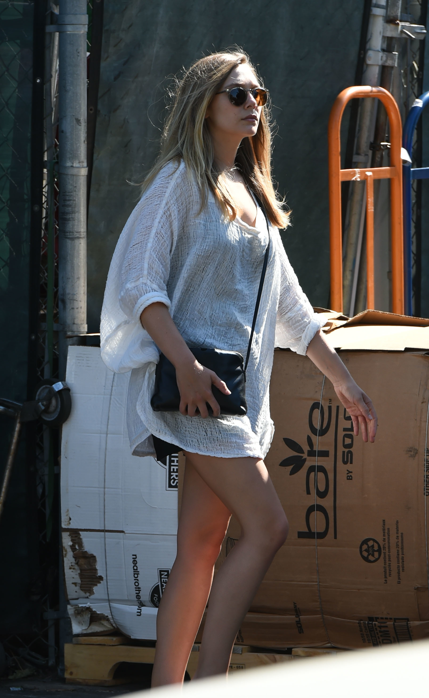 Get The Look: Elizabeth Olsen Grabs Groceries In Casual Flowing Shirt –And Not Much Else