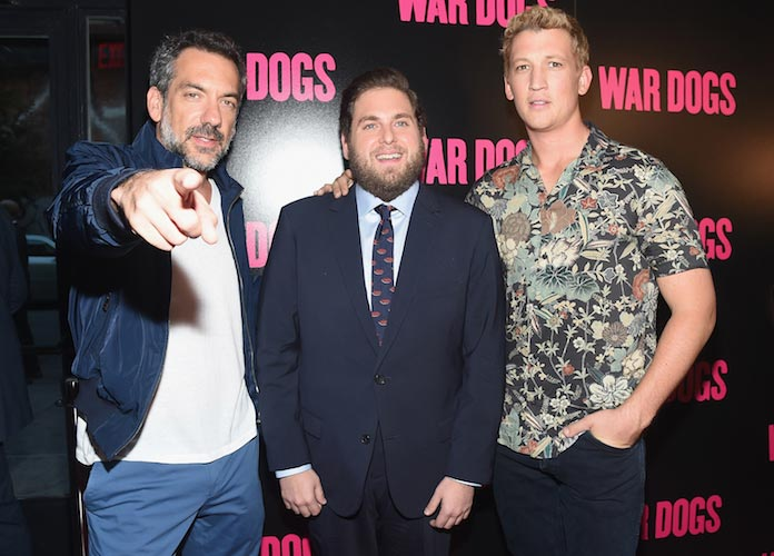Jonah Hill, Miles Teller And Director Todd Phillips Pose At 'War Dogs' Premiere