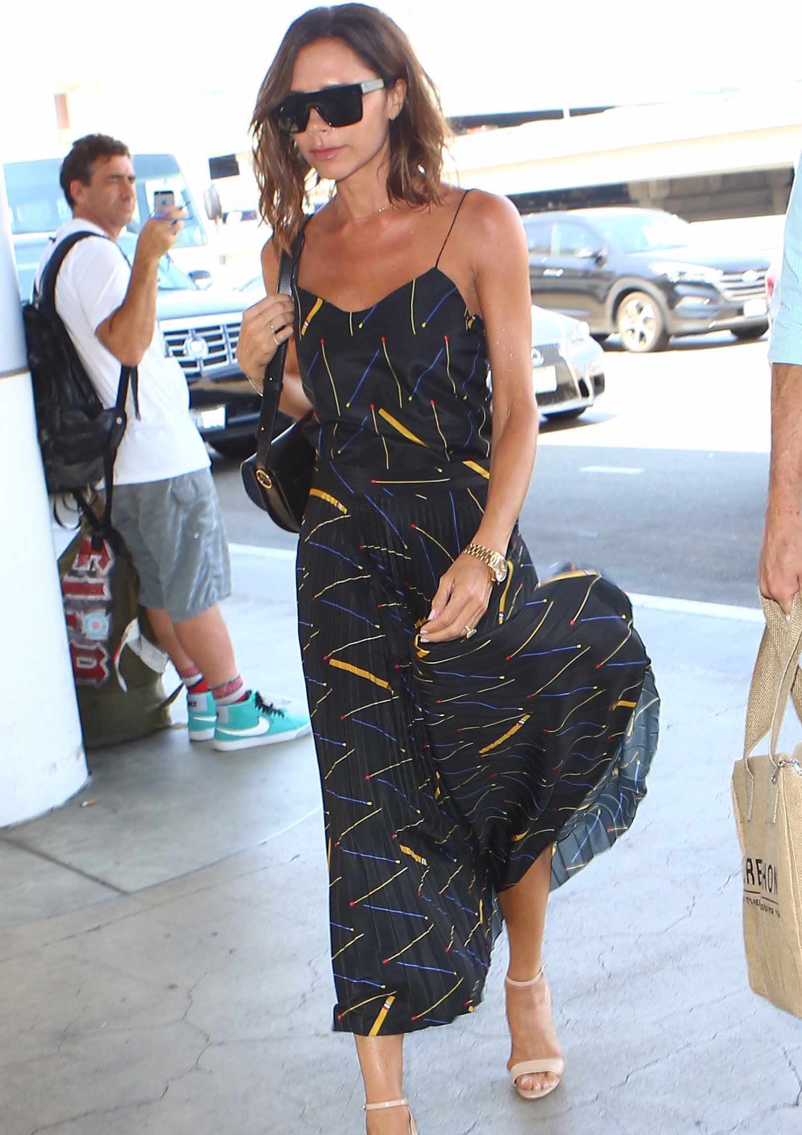 Victoria Beckham Makes Flying Look Chic Again