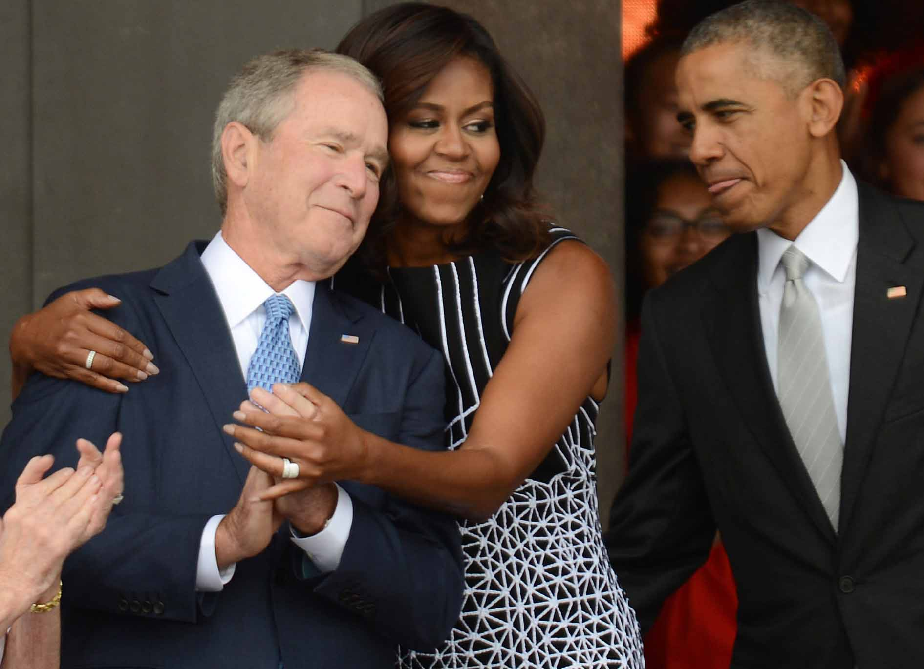 michelle obama hugs george w bush at opening of african