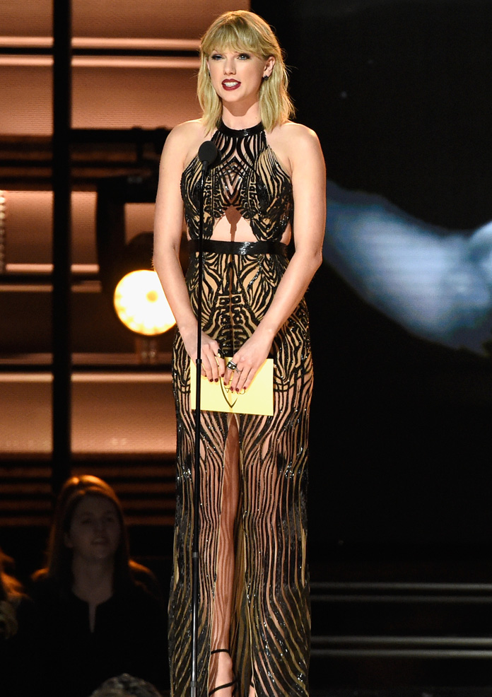 Taylor Swift speaks onstage at the 50th annual CMA Awards