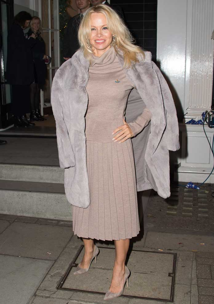 Pamela Anderson Looks Cozy At Stella McCartney's Christmas Light Switch-On