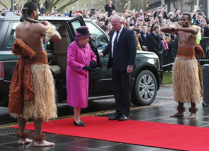 Queen Elizabeth Visits Fijian Exhibition, Greeted By Shirtless Wariors