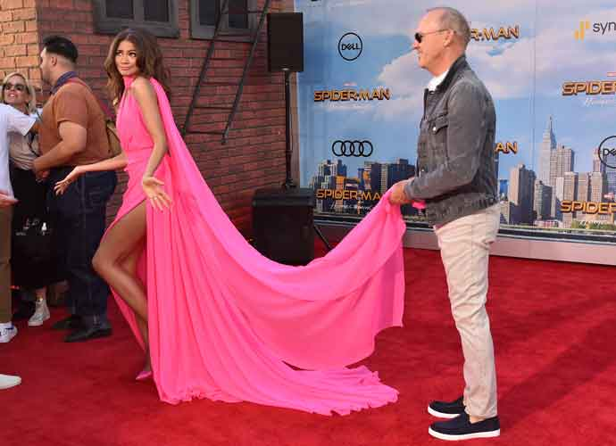 Michael Keaton Holds Zendaya's Dress Train At 'Spiderman: Homecoming' Premiere