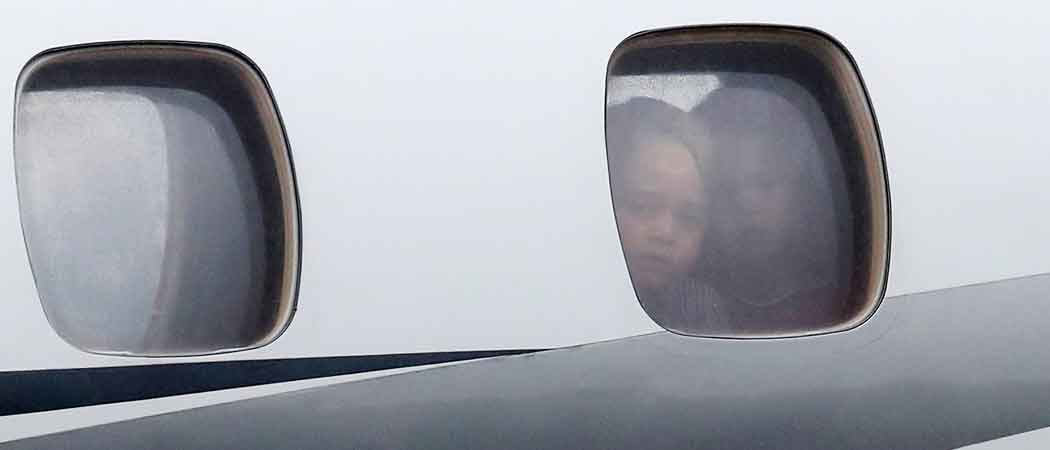 Prince George & Princess Charlotte Peer Out Airplane Window On Royal Visit To Poland