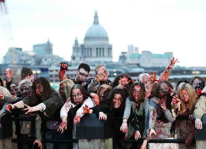 Hundreds Of Zombies March In London In Honor Of 'The Walking Dead's' 100th Episode