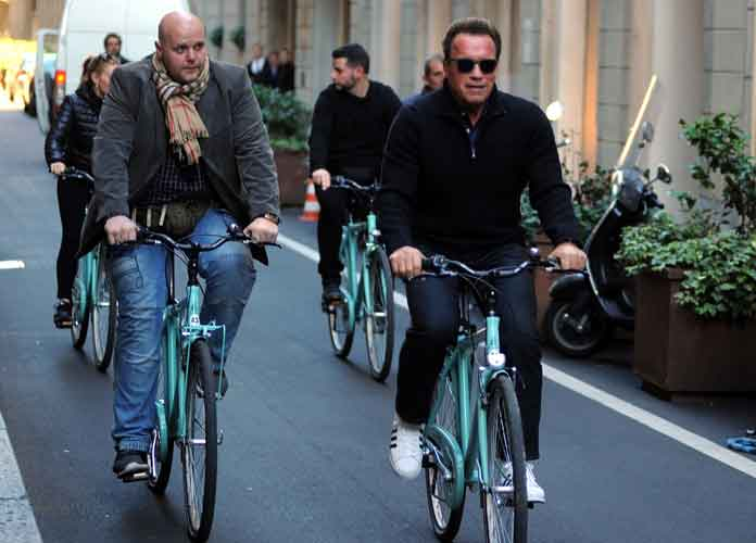 Arnold Schwarzenegger Rides Bikes & Shops In Milan With Girlfriend Heather Milligan
