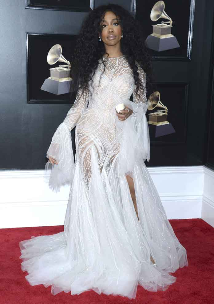 SZA Looks Straight Out Of A Fairytale In All-White Atelier Versace Dress