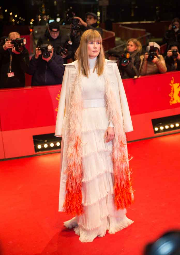Rosamund Pike Wears White Feathered Givenchy Gown To Berlin Film Festival