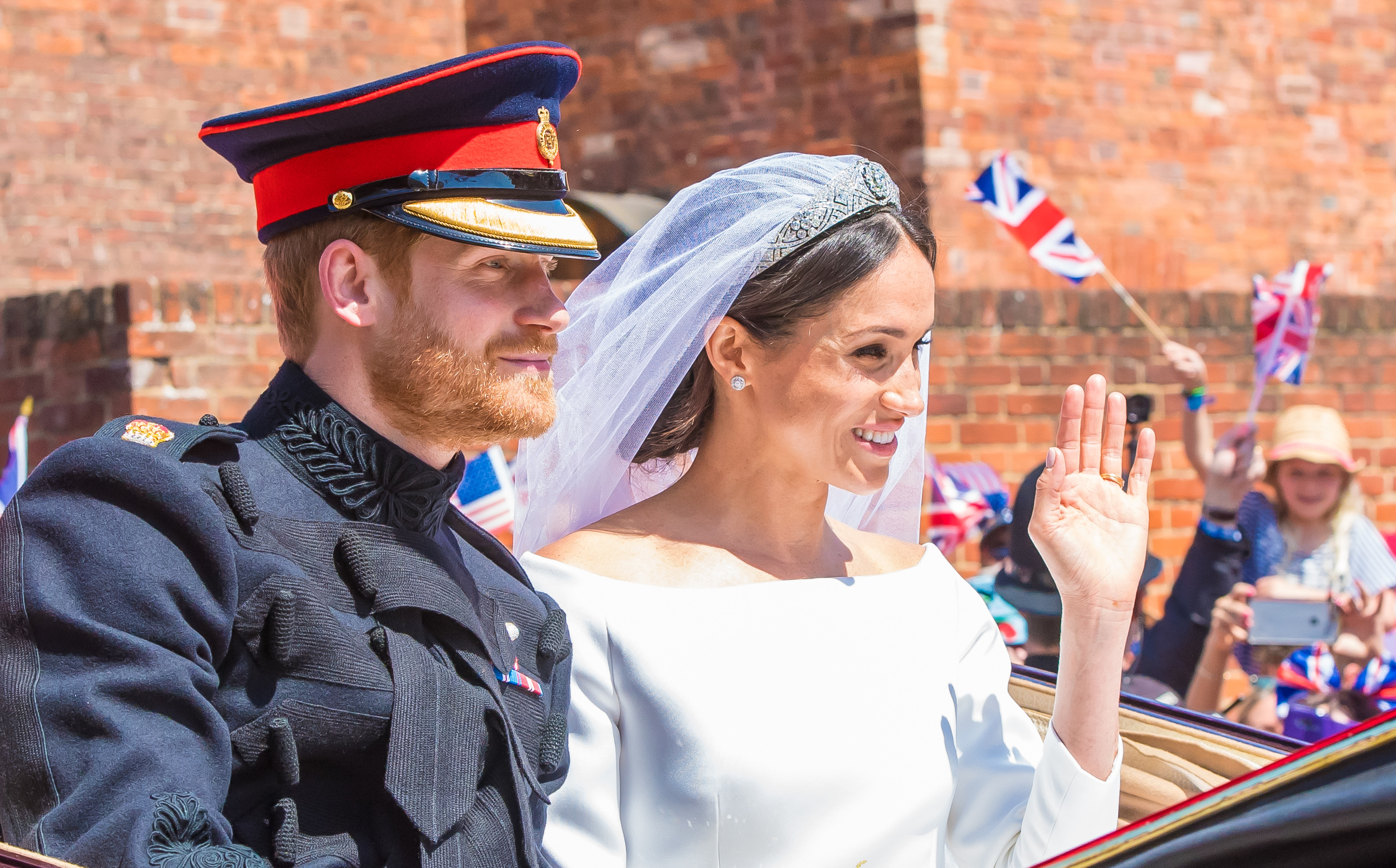 Prince Harry & Meghan Markle Didn't Tell Queen About Decision To 'Step Back' From Royal Duties