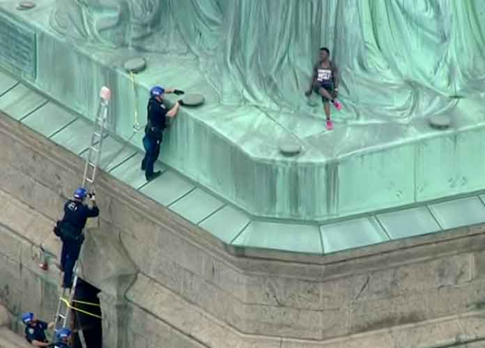 Therese Okoumou Arrested For Protesting Trump's Immigration Policy By Climbing Statue Of Liberty