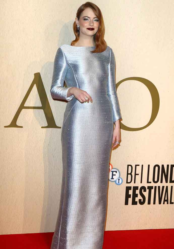 Emma Stone Shined In A Silver Metallic Louis Vuitton Dress At London Premiere Of 'The Favourite'