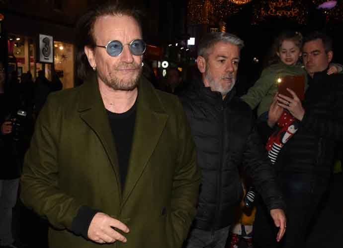 Bono & The Edge Perform At Christmas Eve Busk