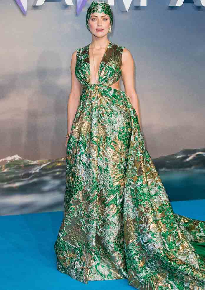 Amber Heard Dazzles In Green Swim Cap & Dress At London Premiere Of 'Aquaman' [PHOTO]