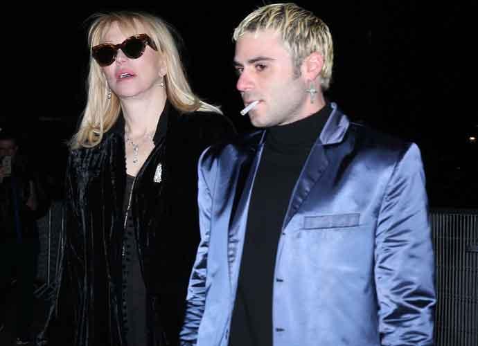 Courtney Love Attends Celine's Menswear Show In Paris With Henri Levy, Demi Lovato's Boyfriend