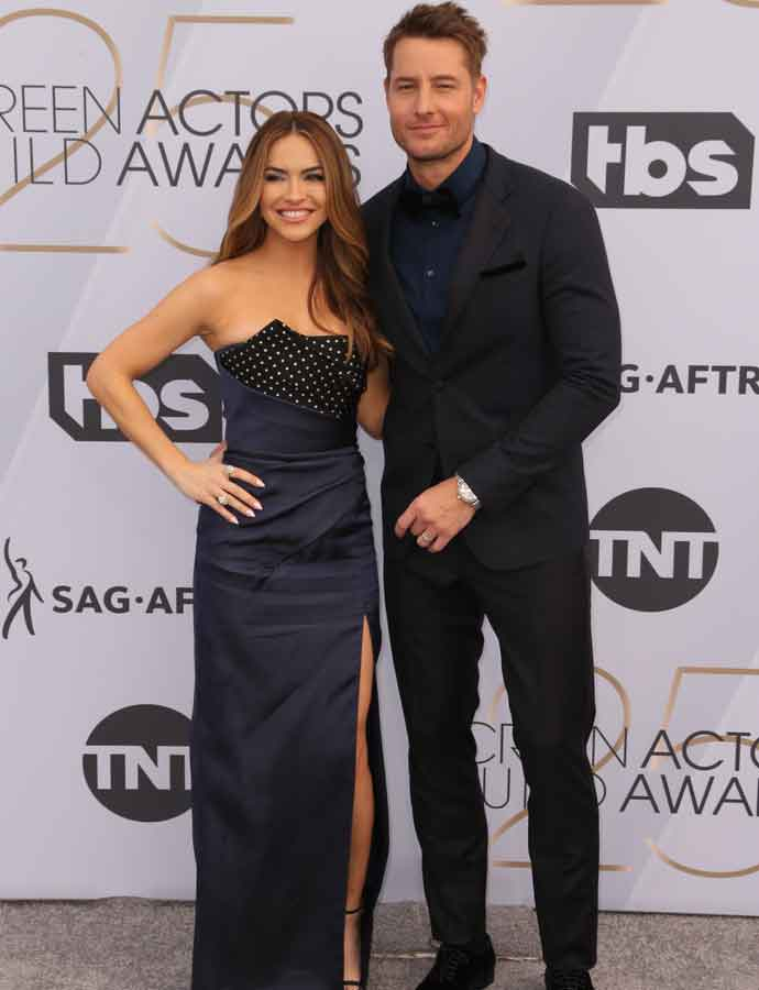 Justin Hartley & Wife Chrishell Hartley Cuddle On The Red Carpet At SAG Awards 2019