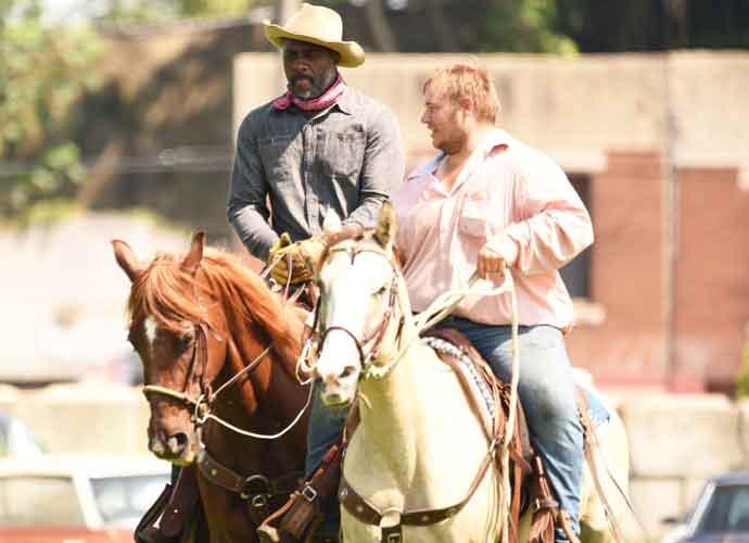 Idris Elba Rides Horseback On Set Of 'Concrete Cowboy'