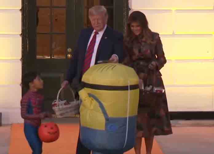 Donald & Melania Trump Put Candy Bar On Head Of Child Dressed As Minion For Halloween