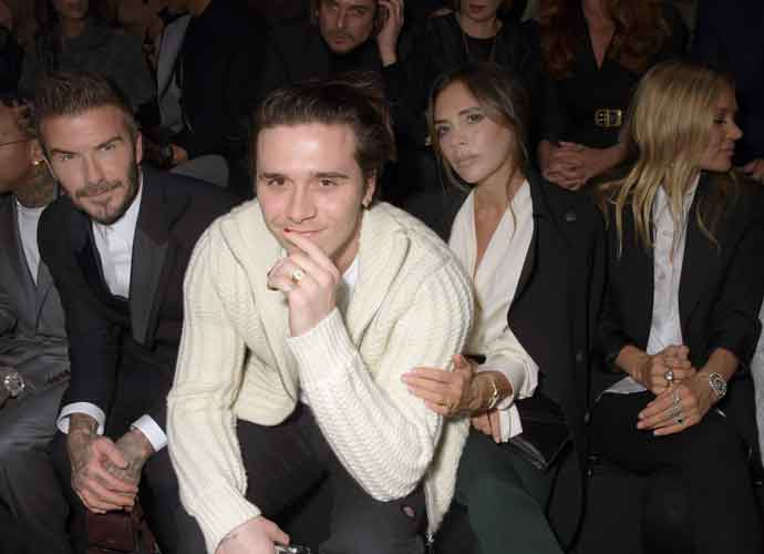 David, Victoria & Brooklyn Beckham Sit Front Row At Dior Homme Show