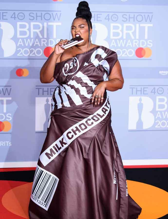 Lizzo Wears A Chocolate Bar-Inspired Dress & 'Eats' Hershey Handbag At Brit Awards