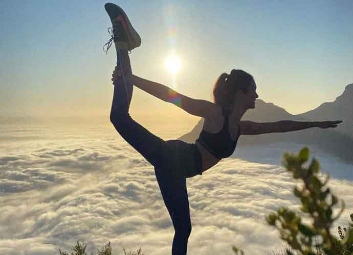 Nina Dobrev Strikes A Yoga Poses in Cape Town, South Africa