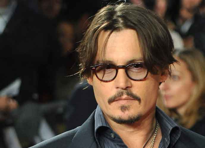 Johnny Depp Makes A Bra Out Of A Napkin In His First Instagram Post