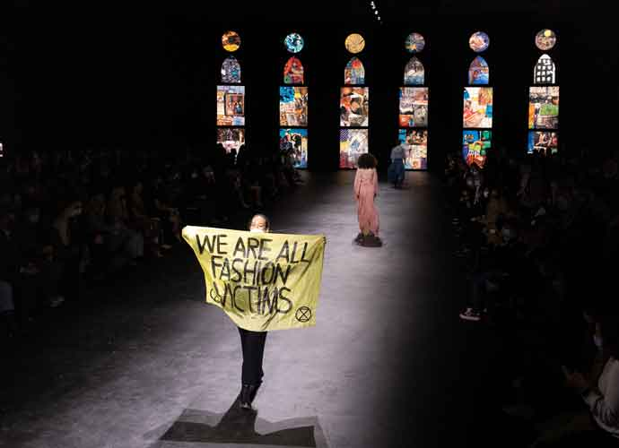 Environmental Protestor Walks Runway During Dior's Paris Fashion Week Show: 'We Are All Fashion Victims'