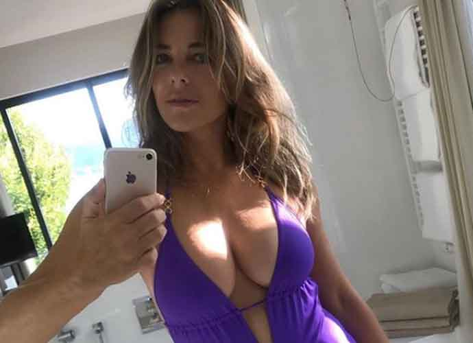 Elizabeth Hurley, 55, Stuns In Plunging Violet Swimsuit Photos