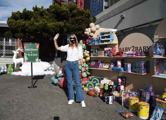 Masked Gwyneth Paltrow Passes Out Gifts At Baby2Baby Holiday Drive-Thru In L.A.