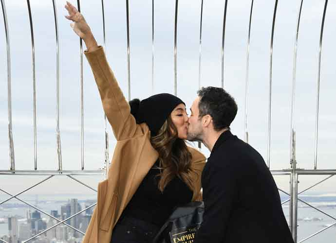 Tayshia Adams & Zac Clark Kiss On Top Of The Empire State Building