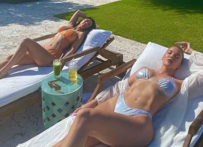 Kourtney & Khloe Kardashian Lay Poolside In Bikinis On Turks & Caicos Vacation