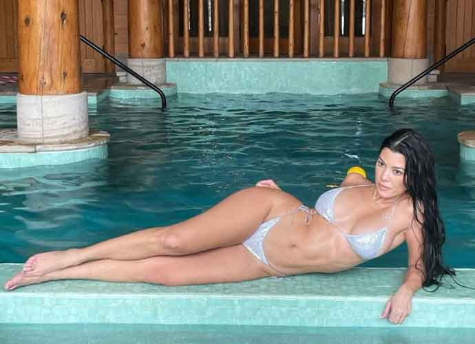 Kourtney Kardashian Relaxes Poolside In A Bikini In Aspen