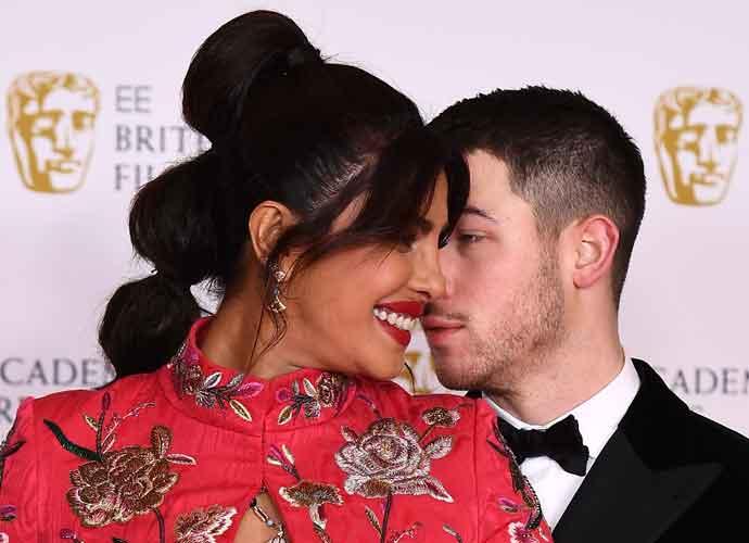 Priyanka Chopra Snuggles Up To Nick Jonas On The BAFTA's Red Carpet