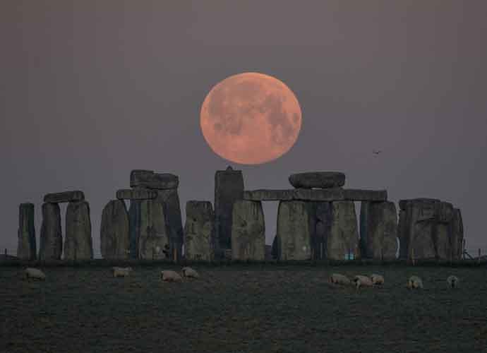 Pink Supermoon Illuminates Night's Sky Over Stonehedge