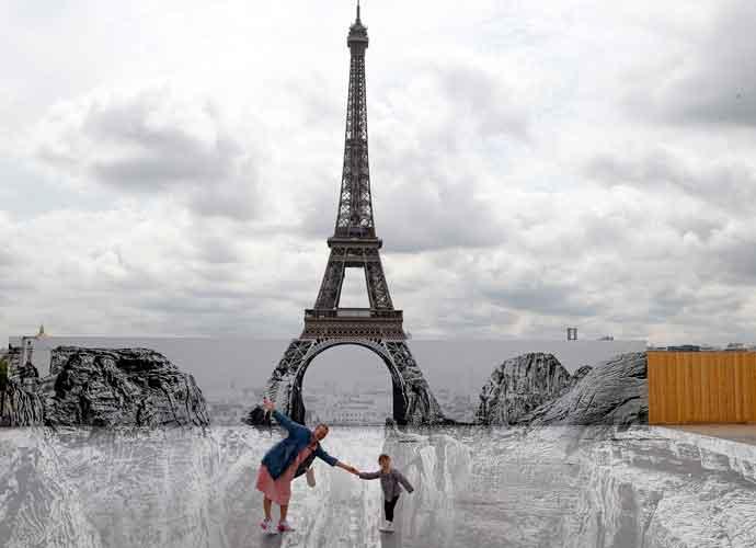 Artist JR Creates A 'Canyon' Illusion Below The Eiffel Tower In Paris