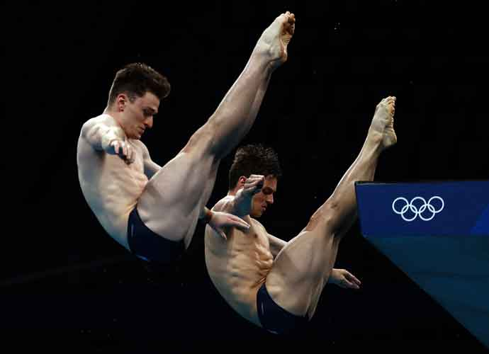 British Diver Tom Daley Wins Olympic Gold Medal, Husband Dustin Lance Black & Son Share In Moment