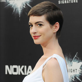 Anne Hathaway Trades Black Tights For Flowing Whites At 'Dark Knight' Premiere