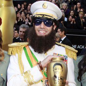 VIDEO: Sacha Baron Cohen Dumps 'Ashes' On Ryan Seacrest At Oscars