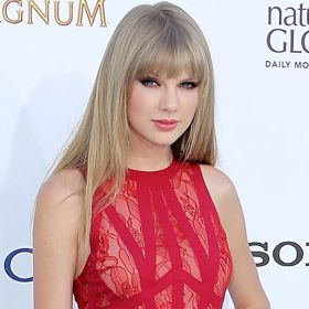 WATCH: Taylor Swift And Harry Styles Kiss At Midnight On New Year's Eve