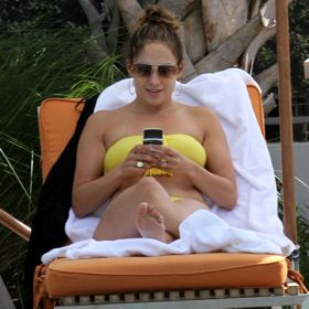 J. Lo Shows Off Her Yellow Bikini Poolside